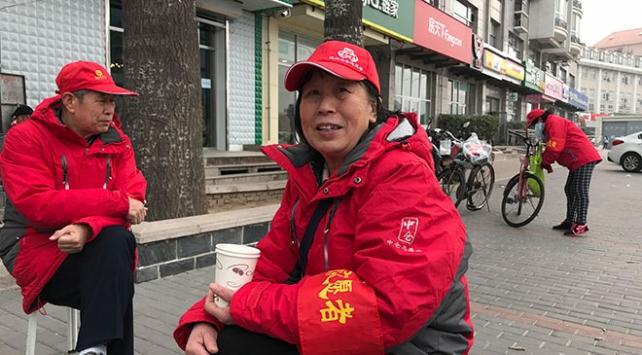 Pekin sokakları yüz binlerce gönüllünün gözetiminde