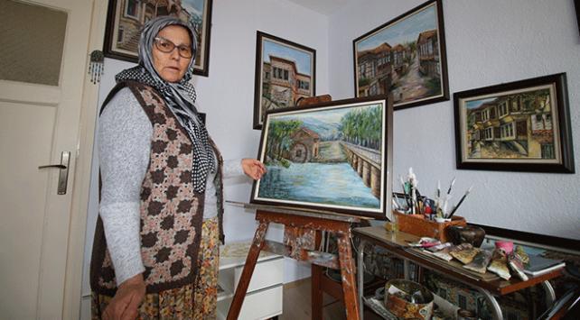63 yaşındaki ev hanımı 16ncı resim sergisini açıyor