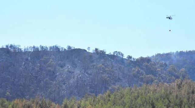 Fethiyeye sıçrayan orman yangını söndürüldü