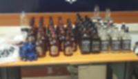 Mahalle berberinden 14 şişe sahte içki çıktı