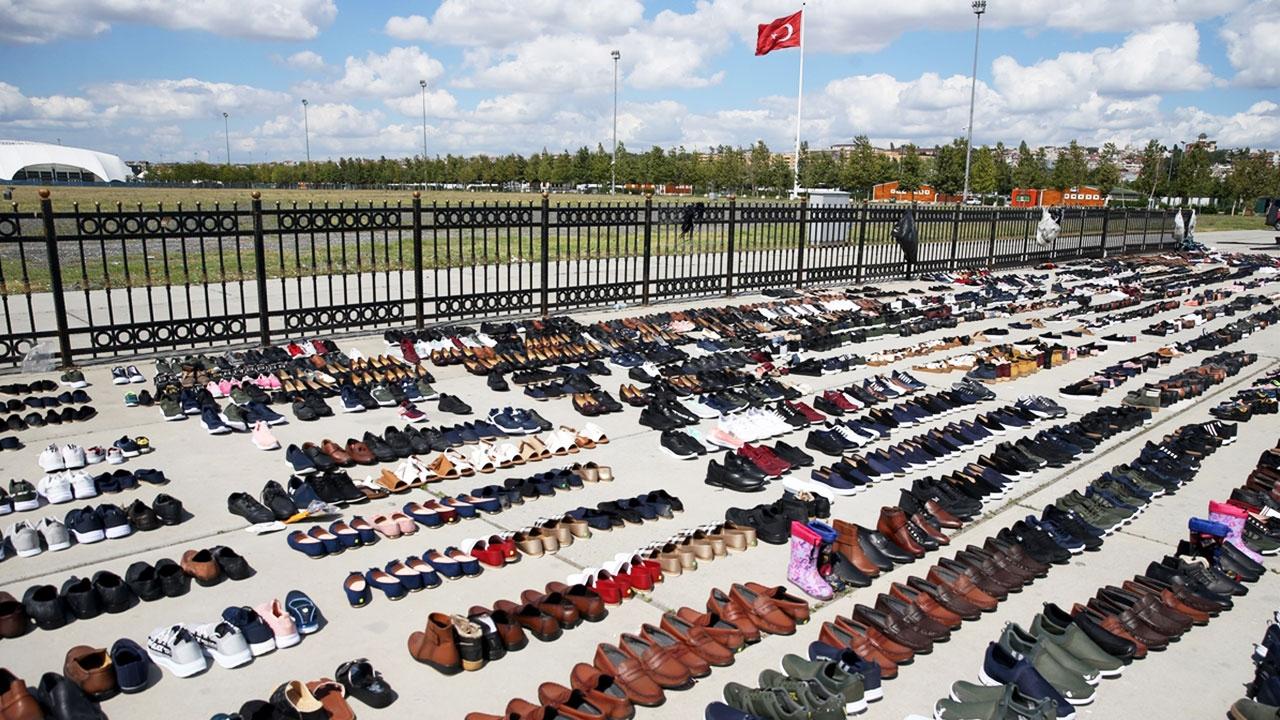 Selde ıslanan ayakkabılar Yenikapıda kurutuluyor