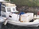 Muğla'da fırtınada teknesi kıyıya vuran balıkçı kayboldu