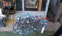 Orijinal alkol şişelerine sahte içki dolduran şüpheli yakalandı