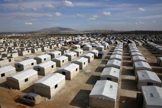 İHH, İdlibli göçmen 200 aileyi briket evlere yerleştirdi