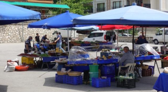 Köy pazarı kurban kesilerek açıldı