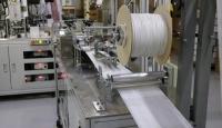 Ümraniye'de bir fabrikada maskeler el değmeden üretiliyor