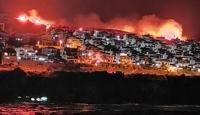 İzmir'de makilik alanda çıkan yangına müdahale ediliyor
