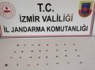 İzmir'de tarihi eser niteliğindeki 38 madeni obje ele geçirildi