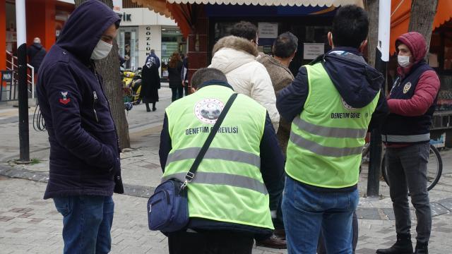 Maske takmayan ve yasak yerde sigara içen kişiye 1800 lira ceza