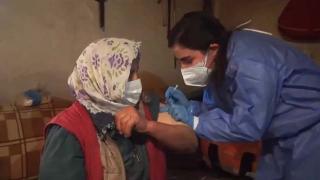 Bakan Koca, aşılama yapan sağlıkçıların görüntüsünü paylaştı