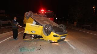 Takla atan araçtan yara almadan kurtuldu