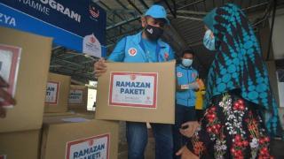 TDV'den Malezya'da ihtiyaç sahiplerine 600 ramazan gıda kolisi yardımı