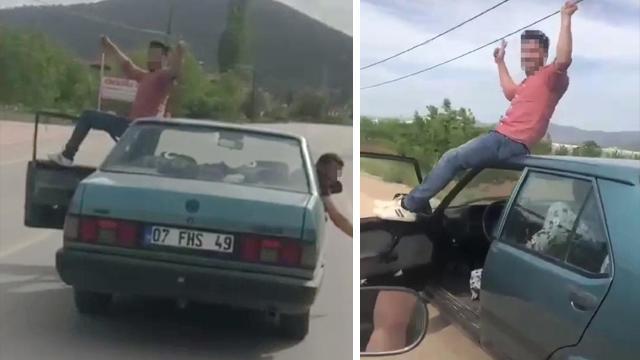 Seyir halindeki otomobilin tavanına oturdu, cezadan kurtulamadı