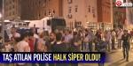 Taş atılan polise halk siper oldu!