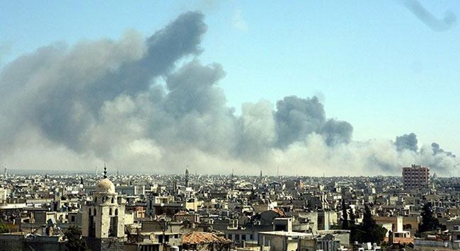 Esed güçleri Humusa havadan saldırdı: 12 ölü