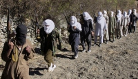 Afganistanda 20 Taliban üyesi teslim oldu