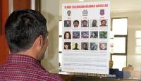 Başına ödül konulan teröristler afişle duyuruldu