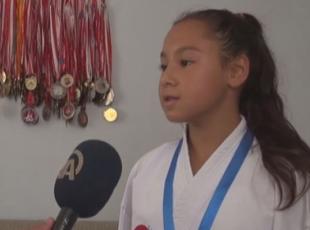Yaşı 12, madalya sayısı 82
