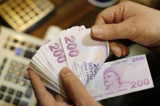 Engelli ailelerine 32 milyon lira yardım