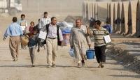 DEAŞın ayırdığı aileler sığınmacı kampında kavuşuyor