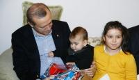 Erdoğandan 15 Temmuz şehitlerinin ailelerine ziyaret