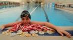 Su korkusunu yendi, yüzmede şampiyon oldu