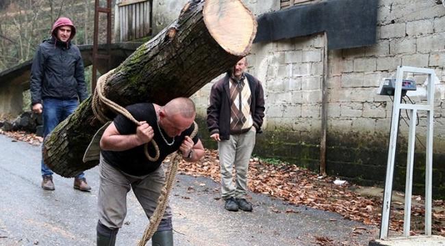 Rizenin Rambosu 283 kilogramlık kütüğü sırtında taşıdı