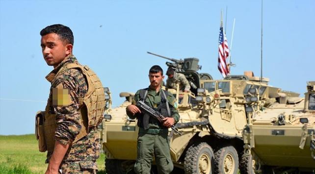 ABDden gelenler YPG üniforması giyip, kalaşnikof taşıyorlardı