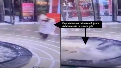 Yürürken cep telefonuyla uğraşan kadın havuza düştü