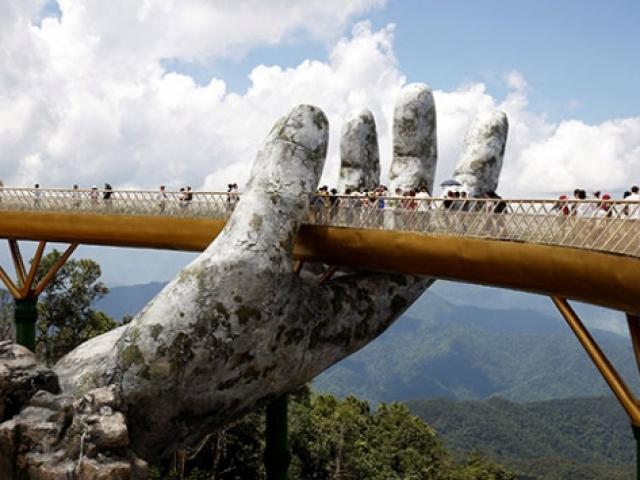 Devasa eller arasında yürüyüş yolu: Vietnam Altın Köprü